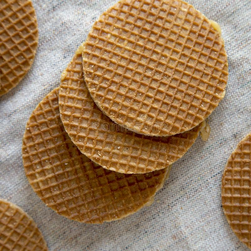 Homemade Dutch caramel waffles on cloth, top view. Top view, from above. Closeup.  royalty free stock photo
