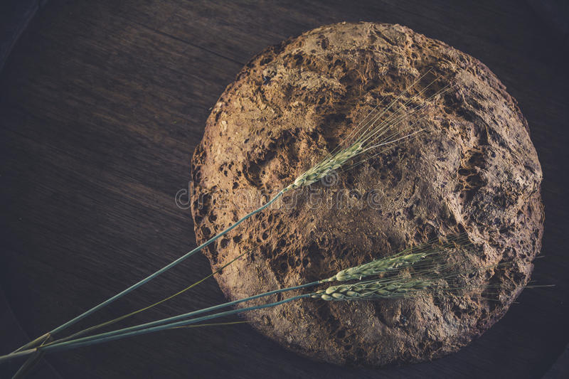 Homemade eco bread. Homemade bread without yeast, gluten-free, baking powder. Eco bread with flax seeds and raisins made from rye flour stock photos