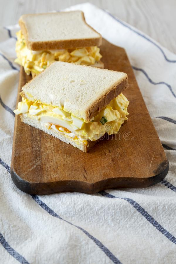 Homemade egg sandwich for breakfast on rustic wooden board, low angle view. Closeup royalty free stock image
