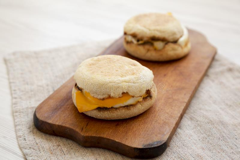 Homemade egg sandwich with cheese on a rustic wooden board, low angle view. Closeup.  royalty free stock photography