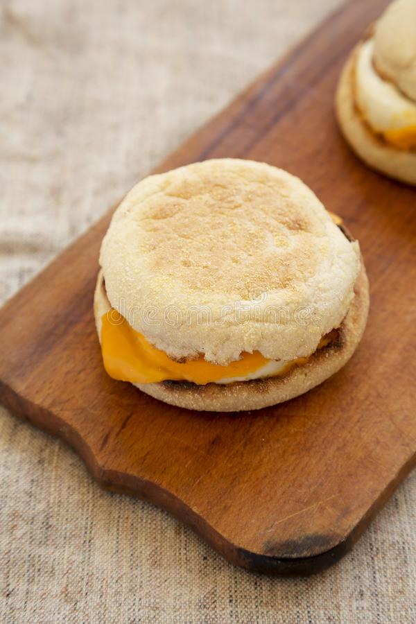 Homemade egg sandwich with cheese on a rustic wooden board, low angle view. Closeup.  stock photos