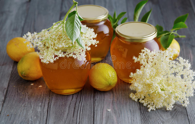 Homemade Elderflower Jelly. Elderflower and lemon jelly in jars on wooden table stock photography