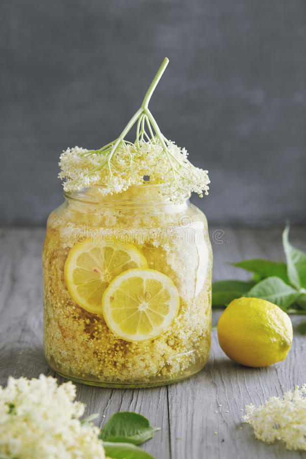 Homemade Elderflower Syrup. Elderflower syrup being made with lemon slices royalty free stock photo