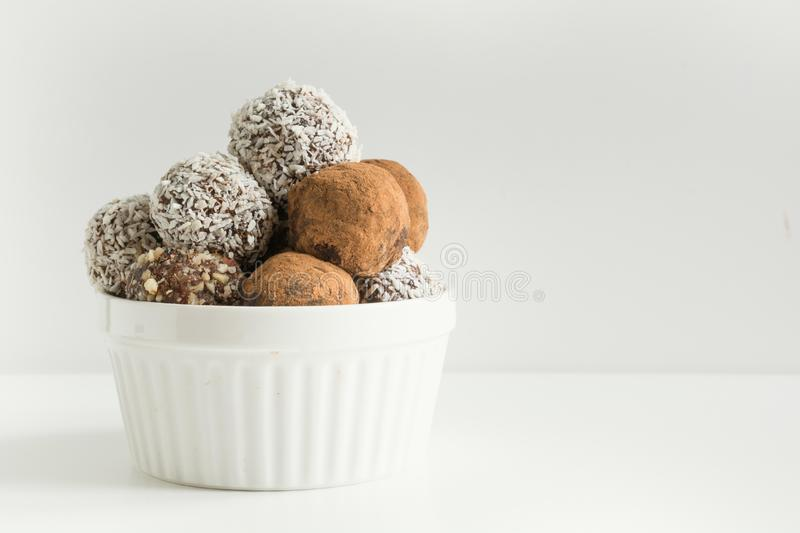 Homemade energy balls with cacao, coconut. Healthy food for children, sweets substitute. Homemade energy balls with cacao, coconut. Healthy food for children stock photo