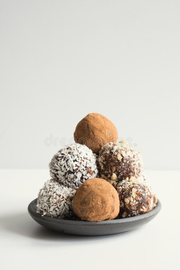 Homemade energy balls with cacao, coconut. Healthy food for children and vegan, sweets substitute. Space for text royalty free stock photos