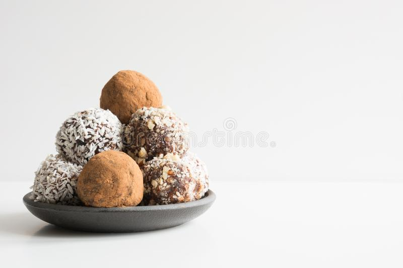 Homemade energy balls with cacao, coconut. Healthy food for children and vegan, sweets substitute. Space for text royalty free stock image