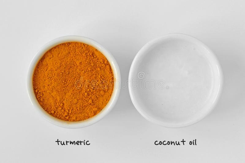 Homemade face mask made out of turmeric and coconut oil royalty free stock image