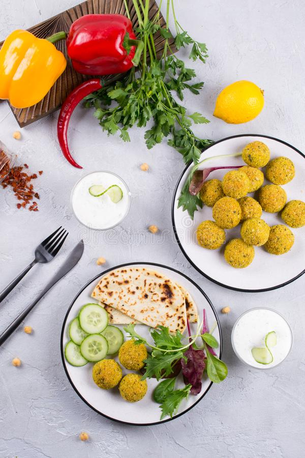 Homemade falafel balls,sweet red pepper and green fresh parsley. royalty free stock images
