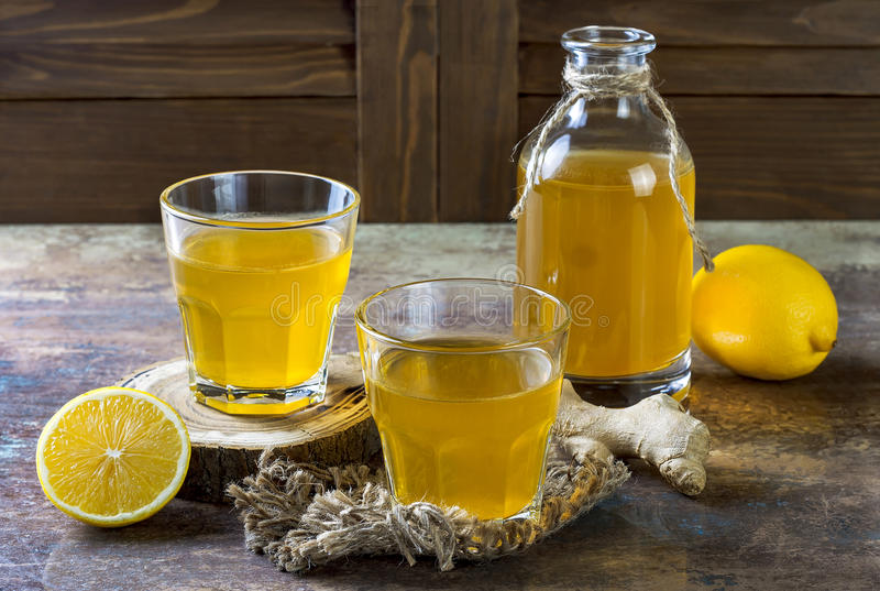 Homemade fermented raw ginger lemon kombucha tea. Healthy natural probiotic flavored drink. Copy space. Homemade fermented raw ginger lemon kombucha tea royalty free stock photography