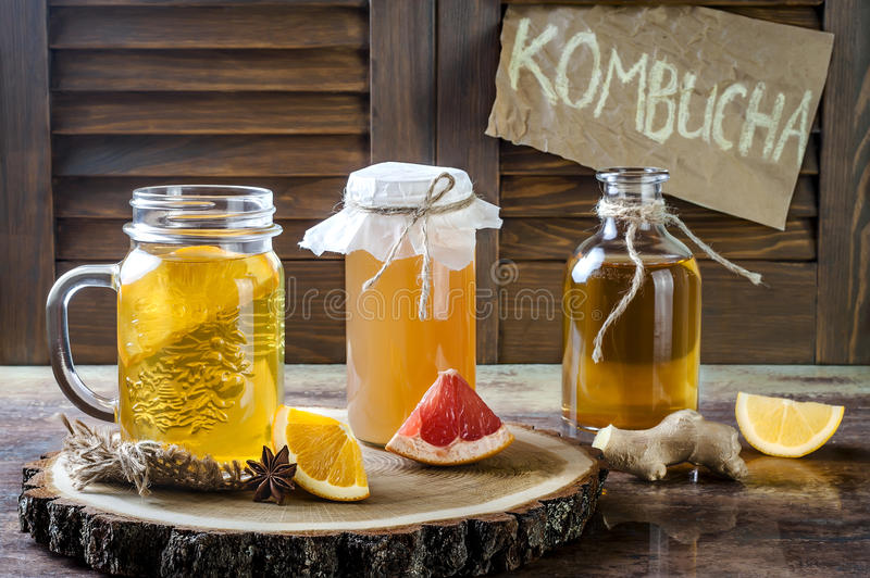 Homemade fermented raw kombucha tea with different flavorings. Healthy natural probiotic flavored drink. Copy space. Homemade fermented raw kombucha tea with