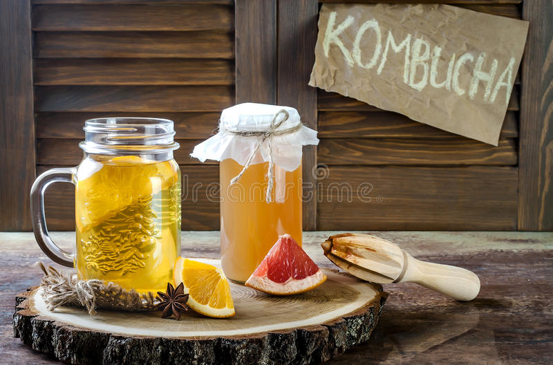 Homemade fermented raw kombucha tea with different flavorings. Healthy natural probiotic flavored drink. Copy space. Homemade fermented raw kombucha tea with royalty free stock photo