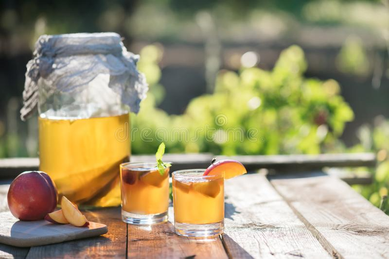 Homemade fermented raw kombucha tea with different flavorings. Healthy natural probiotic flavored drink. Superfood. Homemade fermented raw kombucha tea with stock photos
