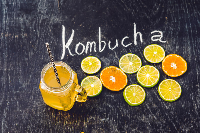 Homemade Fermented Raw Kombucha Tea Ready to Drink With orange and lime. Summer.  royalty free stock image