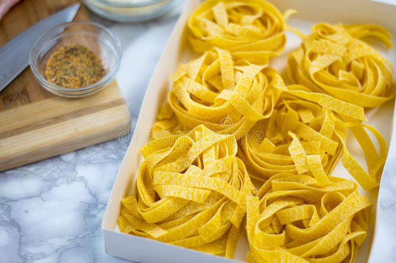 Homemade Fettuccine Pasta Ready to Be Cooked. Delicious looking fettuccine pastas in the kitchen ready to be boiled royalty free stock images