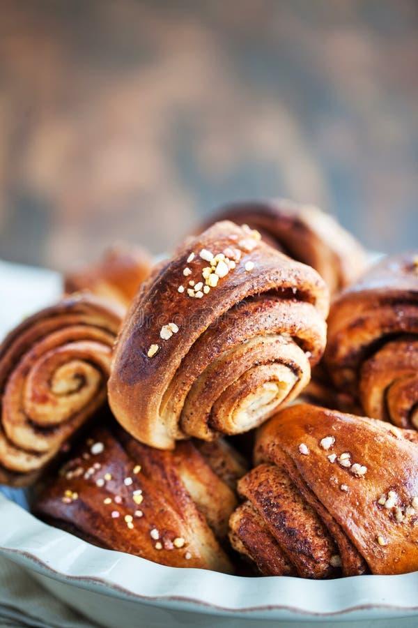 Homemade finnish cinnamon and cardamom rolls stock images