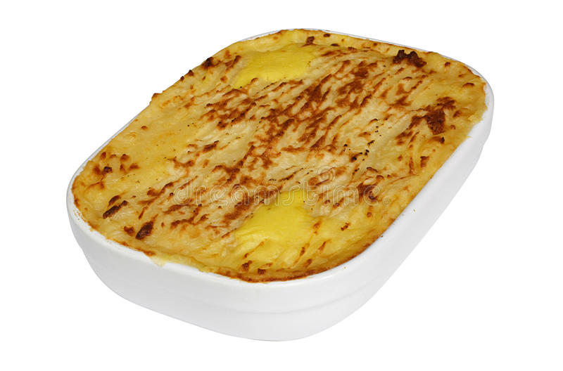 Homemade Fish pie isolated. Traditional Homemade Fish Pie in a casserole dish with crispy mashed potatoes on the top stock photos