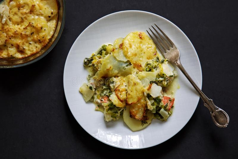 Fish pie with sliced potato topping. Homemade fish pie with salmon and haddock and sliced potato topping stock images