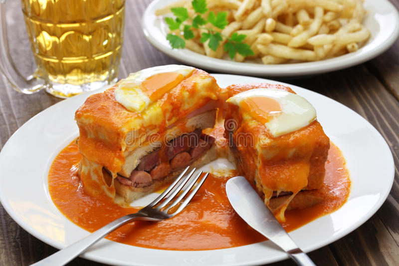 Homemade francesinha, portuguese sandwich. And french fries royalty free stock image