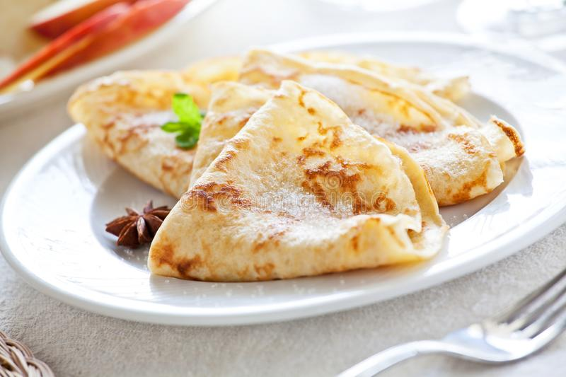 Homemade French Crepes. Bunch of homemade french crepes with sugar stock photo