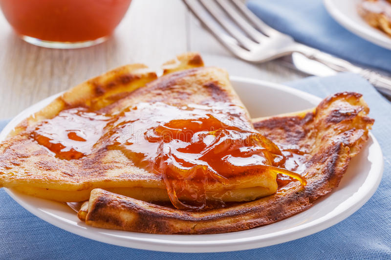 Homemade french crepes with orange syrup. stock photos