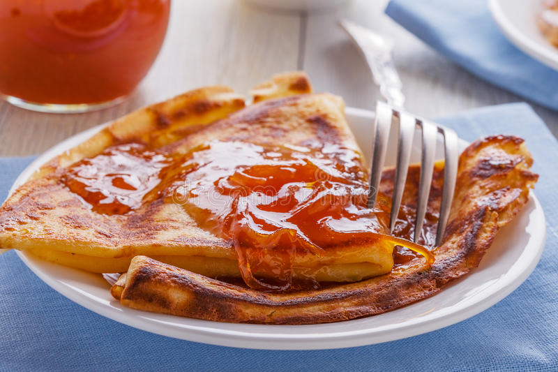 Homemade french crepes with orange syrup. stock image