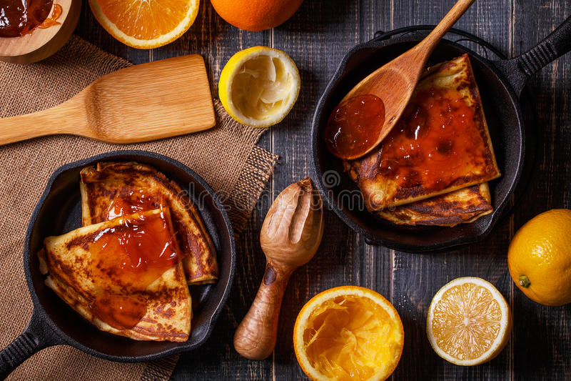 Homemade french crepes with orange syrup. Homemade french crepes with orange syrup, top view stock photo