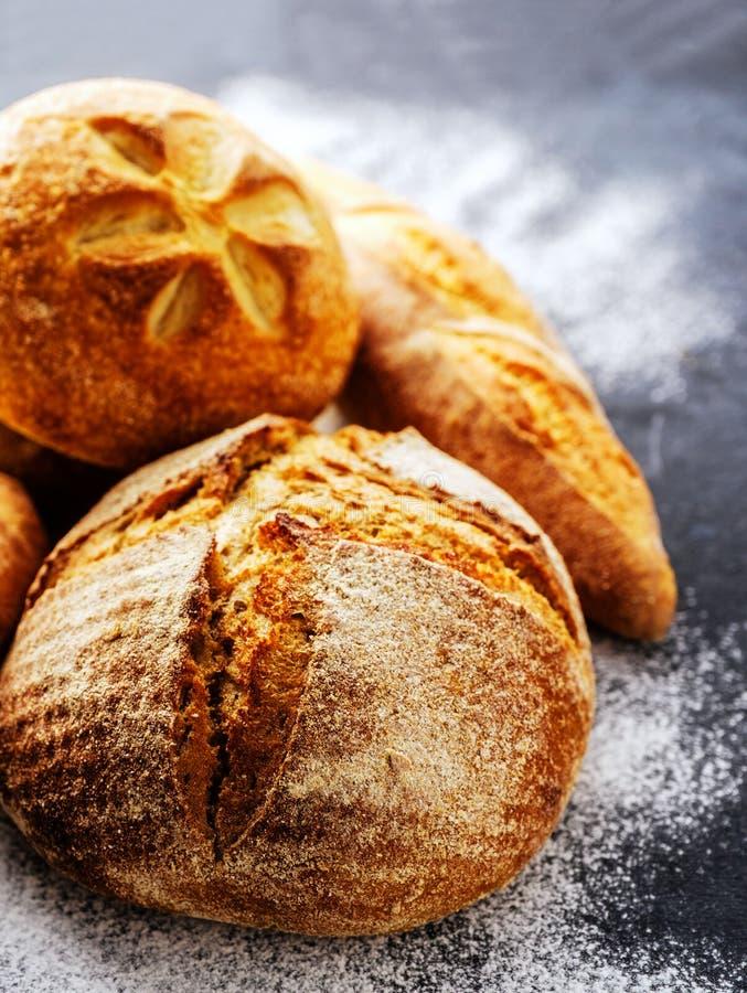 Homemade fresh bread on the dark table stock image