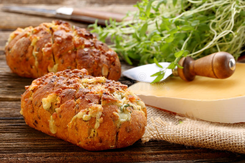 Homemade fresh bread stuffed cheese and garlic with herbs stock image