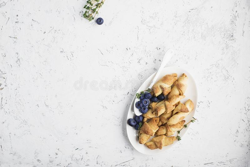 Homemade fresh cookies dusted powdered sugar in white plate stock image