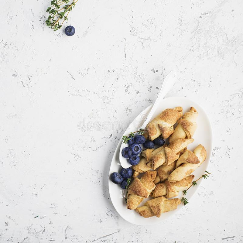 Homemade fresh cookies dusted powdered sugar in white plate stock photography