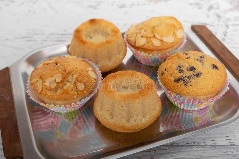 Homemade fresh muffins with chocolate and mandula royalty free stock photos