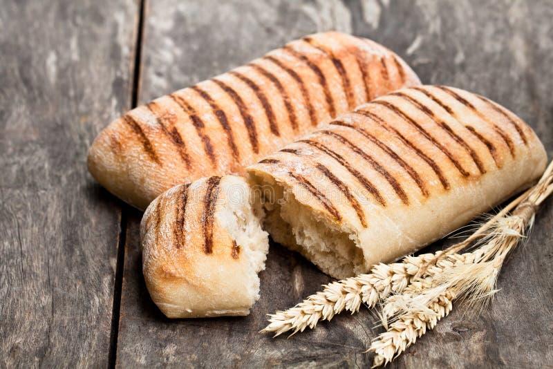 Homemade fresh panini bread on white royalty free stock photo