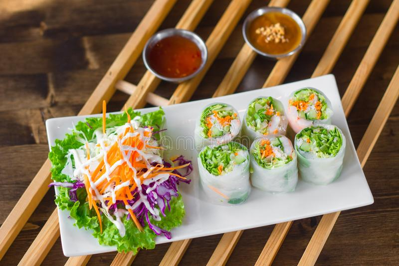 Fresh spring rolls. Homemade fresh spring rolls are a refreshing change from the usual fried variety, and have become a family favorite. They are great as a cool royalty free stock photography