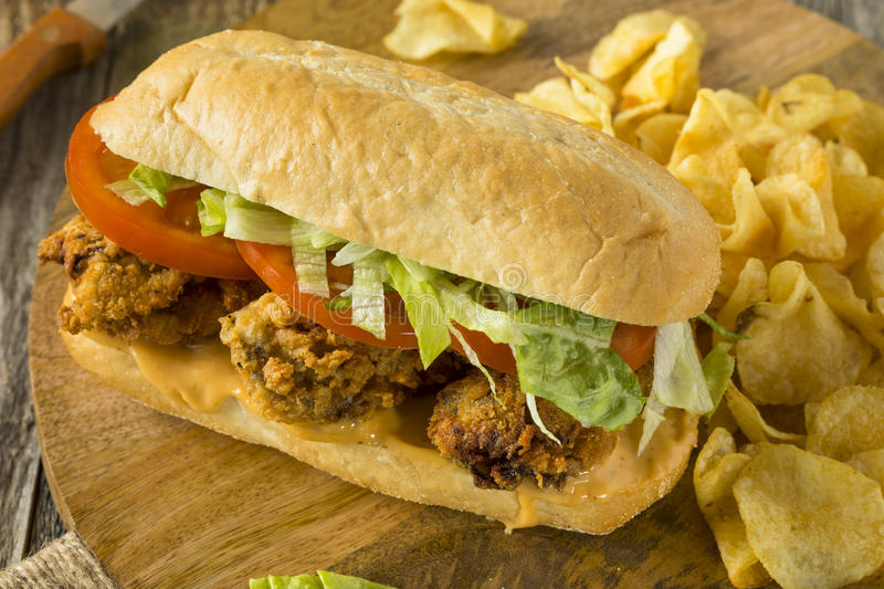 Homemade Fried Oyster Po Boy Sandwich. With Lettuce and Tomato royalty free stock photo