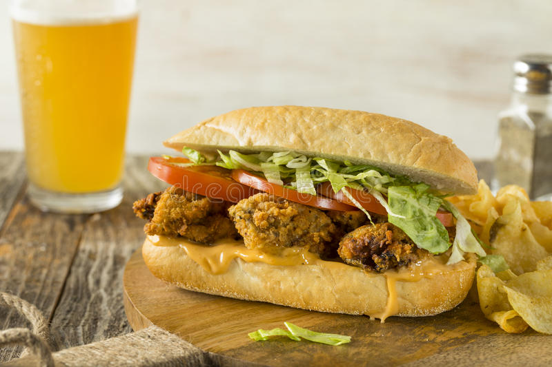 Homemade Fried Oyster Po Boy Sandwich. With Lettuce and Tomato stock photos