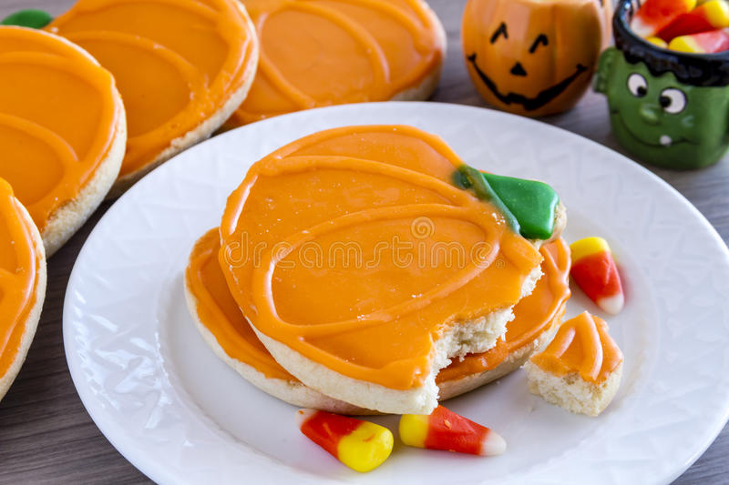 Homemade Frosted Pumpkin Sugar Cookies stock photo