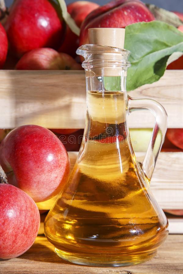 Homemade fruit canning, diet healthy food and drink. Apple cider vinegar, juice, salad dressing from a crop of ripe red garden royalty free stock photos