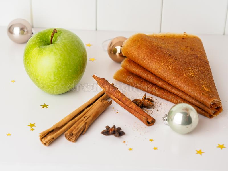 Homemade fruit leather from mashed apples, traditional Russian winter delicacy. Apple candy, rolled in a roll royalty free stock photography
