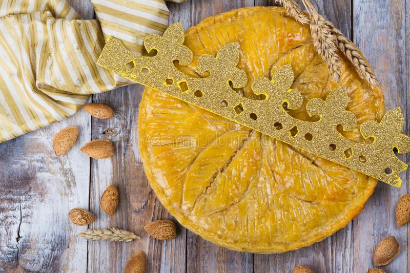 Homemade Galette des Rois cake with handmade kings crown. Traditional French Epiphany cake with ground almond stock photography