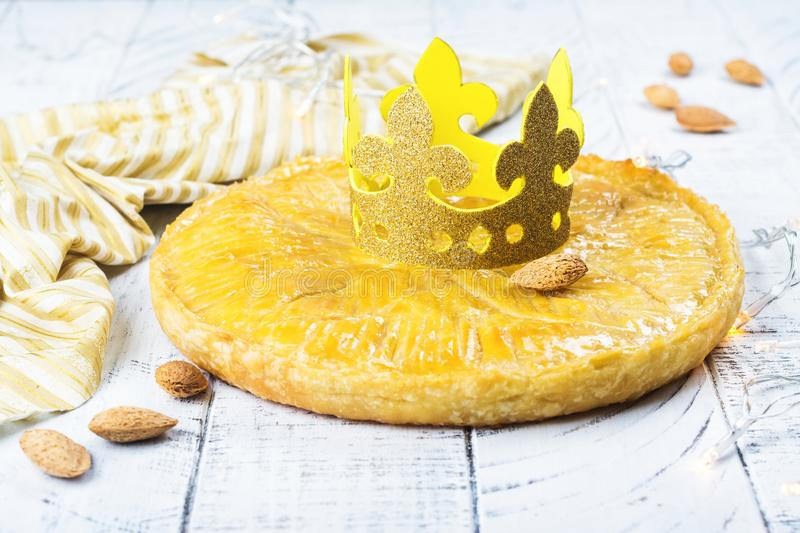 Homemade Galette des Rois cake with handmade kings crown. Traditional French Epiphany cake with ground almond stock image