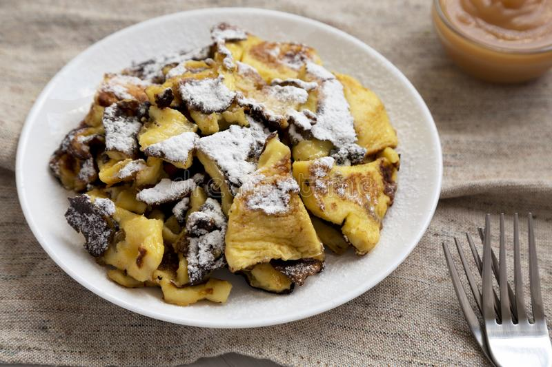Homemade german Kaiserschmarrn pancake on a white plate, low angle view. Closeup.  stock photos