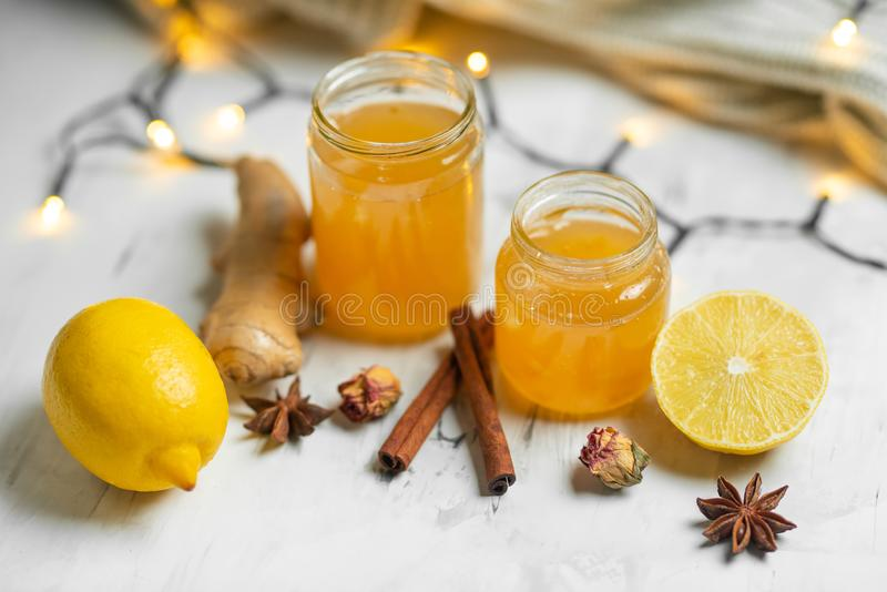 Homemade ginger and lemon jam on a light background, close-up. Natural products to support the immune system in the winter. Phytotherapy. Healthy food, health stock photos