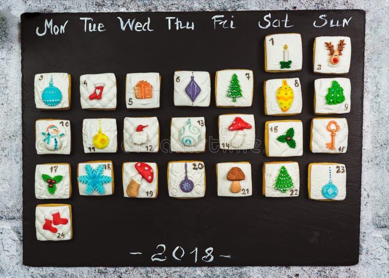 Homemade gingerbread christmas cookies advent calendar on black background stock photos
