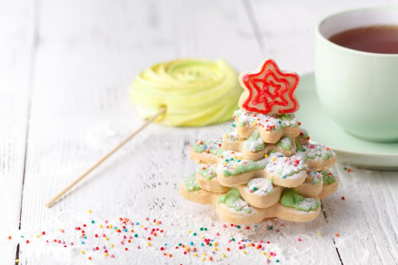 Homemade Gingerbread cookies Christmas Trees, decorated with icing and sugar decorations royalty free stock photos