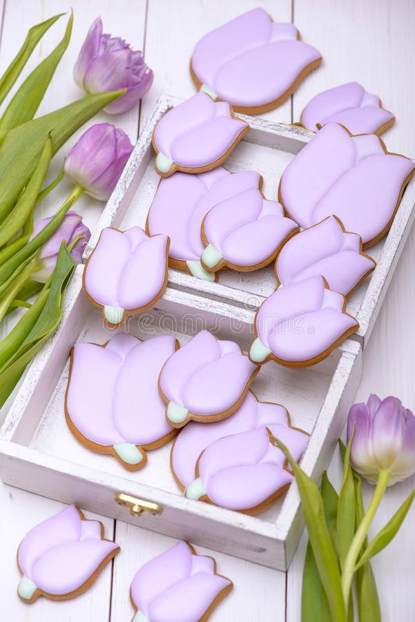 Homemade gingerbread cookies in the shape of purple tulip royalty free stock photography