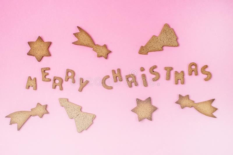 Homemade Gingerbread Cookies in Shape of Stars and Spruce and Cookies in Shape of Letters on Pink Background Christmas Food stock image