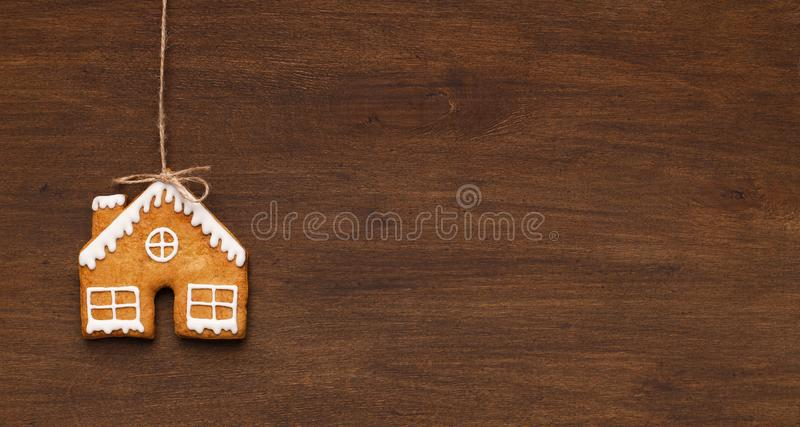 Homemade gingerbread house cookie, copy space stock photo