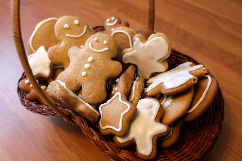 Homemade gingerbread men in the woven basket royalty free stock images