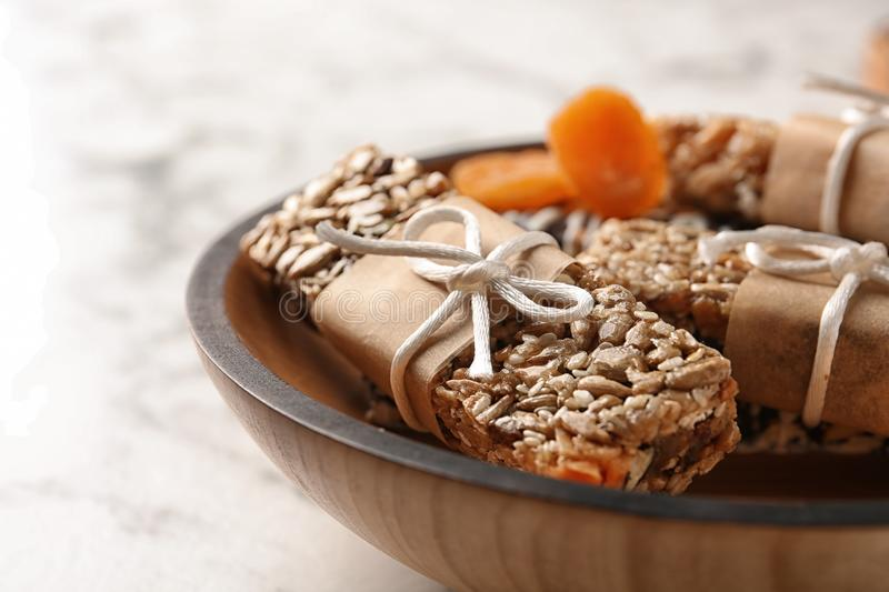 Homemade grain cereal bars on plate, closeup. Healthy snack stock photo