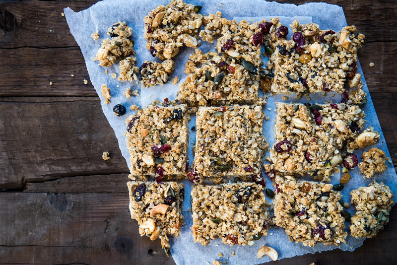 Homemade Granola Bars. Homemade Protein Granola Bars made from Oat Porridge, Nuts, Seeds, Berries and Honey. Rustic Wooden Background, top view stock photo